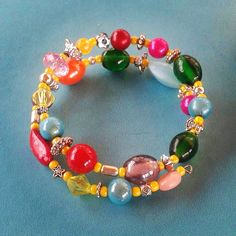 Items similar to multicoloured memory wire bracelet on Etsy Memory Wire Bracelets, Memories, Jewellery, Trending Outfits, Unique Jewelry, Handmade Gifts, Etsy, Vintage, Jewerly