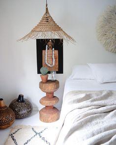 #bedroomdecor –ethiopian stool, kenyan gourds, tunisian pandant, banimleke juju hat, linen, moroccan beni ourain rug – : @apartmentf15