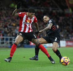 Patrick van Aanholt of Sunderland vies with Nathaniel Clyne of Liverpool during the Premier League match between Sunderland and Liverpool at Stadium of Light on January 2, 2017 in Sunderland, England.