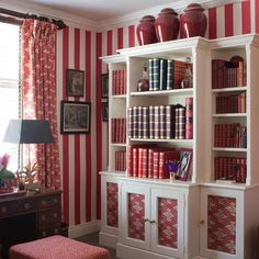 Some pattern play in this Kensington study with red stripe wallpaper, stool in our Safari Cotton in Crimson fabric and our Via Krupps Red on White as curtains and on cabinet panels. . . #paolomoschinofornicholashaslam #pattern #fabric #red  #london #interiors #interiordesigner #design  #interiorstyle #interiordesign #interiorinspo #interiordetails #kensington #chelsea