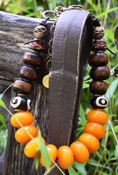 African-Inspired Batik Brown Bone, Brass, Leather and Amber Resin Tribal Choker Necklace African Museum, Wooden Plugs, Amber Resin, Museum Displays, Bone Carving, Amber Color, Collar Styles, Tribal Jewelry, Necklace Designs
