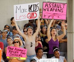 Protesters hold signs calling for more gun controls at a rally three days after the shooting at Marjory Stoneman Douglas High School, in Fort Lauderdale, Florida, U.S., February 17, 2018. REUTERS/Jonathan Drake - RC1853289490
