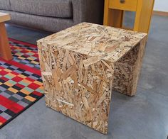 Modern OSB Furniture with Black Accents. This unique and modern piece of furniture is called an Arch Stool. Its made with Oriented Strand Board