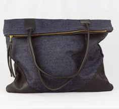 Large Leather   Denim Tote. Perfect for the denim trend of fall, you'll be fashion forward and rocking a fabulously made tote that meets all your carrying needs. www.mooreaseal.com