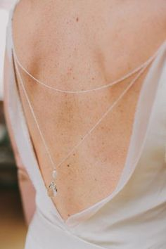 Back jewelry on open-back wedding gown.