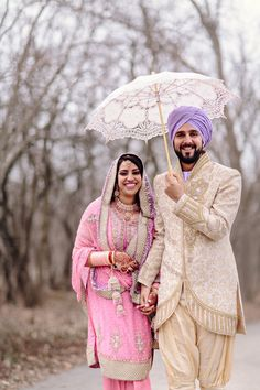 23a Indian Sikh wedding lace umbrella. Couple in pink purple salwar kameez, shervani and turban. More here - http://www.indianweddingsite.com/beautiful-illinois-fusion-sikh-wedding-almond-leaf-studios/