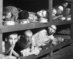 The photo shows prisoners of Gleiwitz concentration camp, a sub camp of Auschwitz. Gleiwitz was made up of four camps that worked with mining and railroad repair. At the the camp the prisoners received little food and as a result were deeply malnourished. The living quarters were so tight that people were piled on top of each other. http://www.edwardvictor.com/Holocaust/Gleiwitz.htm