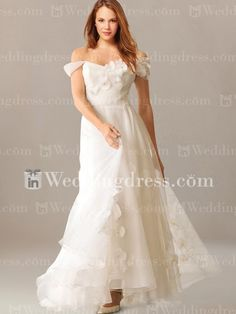 Organza beach wedding gown features a sweetheart neckline.