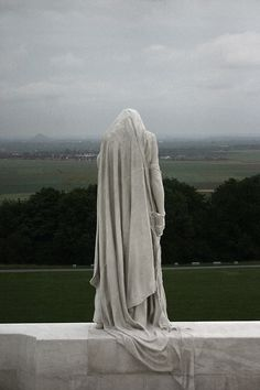 Vimy Memorial.   Notice the seam of the blocks below cutting through the drapery of the sculpture base.