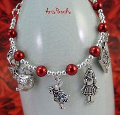 Adorable #Alice in #Wonderland #charm #bracelet. Check out the link in my bio to see this in my store.  #ArtsParadis #OhioMade #handmade #fashion #jewelry #AmazonPrime #Amazon #Etsy #artisanjewelry #handcraftedjewelry #madebyhand #supporthandmade #nofilter #lotd #jotd #Inthe216 #shoplocal #supportsmallbusiness #oktoberfest #nightmarketCLE #oddmallohio #makersgonnamake #IntheCLE #thisisCLE #urbanwear