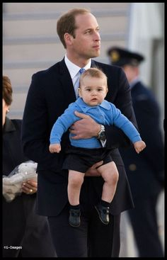 Prince William held his young son Prince George Canberra, Australia. 4/204/14 . i-Images/www.i-Images.co
