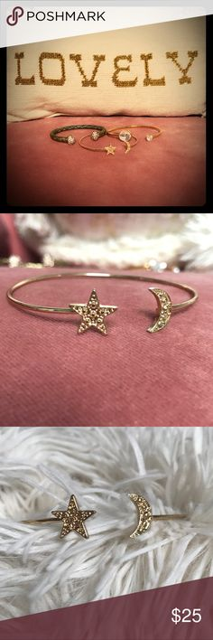 Star and Moon Bangle ⭐️🌙 Pretty little dainty gold adjustable bangle. I love it layered. The set that is in this listing is showing it paired with two Swarovski cuffs. All are for sale. Pair it or wear it alone. (Not real gold. Note there are not crystals on the moon or star, it's more of a textured metal). It's sweet! 🌙⭐️ Jewelry Bracelets