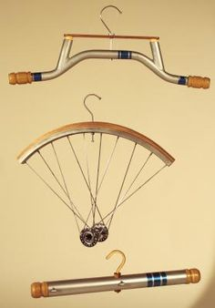 This classifies as art. Bicycle part clothing hangers are a thing of beauty, and there's a tutorial, too.