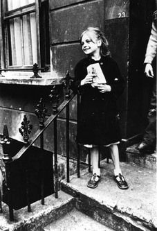 by Roger Mayne, A girl on a door step in Southam Street, North Kensington, 1961