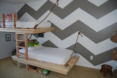 Suspended beds and chevron wall!