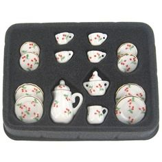 "Miniature Cherry Tea SetThere are 15 pieces in this set that range in size from 3/8"" x 1/2"" to 1"" x 1 1/4"".6.99"