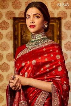 Deepika Padukone in 'The Sabyasachi Red' Benares Revival Saree from our Heritage Collection. Photo Courtesy : Nilaya by Asian Paints. Indian Bridal Outfits, Indian Fashion Dresses, Indian Designer Outfits, Indian Bridal Fashion, Sabyasachi Sarees, Lehenga Choli, Indische Sarees, Deepika Padukone Saree, Shraddha Kapoor
