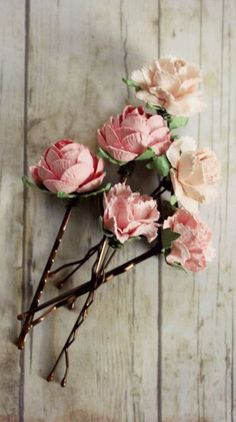 Gorgeous paper flower hair pins in shades of pink colors