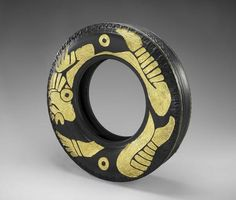 Betsabeé Romero, Guerreros en cautiverio (Captive Warriors), 2006, carved tire with gold leaf.  #goldleaf#art. Mexican artist Betsabeé Romero uses tires as a leitmotiv in her works of art repurposing them by carving new treads with decorative patterns evoking traditional Mexican motifs, as in this artpiece  in which she used gold leaf to ornate the tire, creating a strong contrast between the light and  the darkness of the two materials.