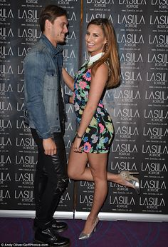 Fun and flirty: Ferne McCann wows in flowery dress and cosies up to on-off beau Charlie Sims as she launches exclusive SS14 fashion collecti...