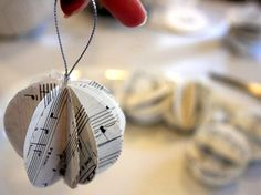 20 Easy Handmade Holiday Ornaments and Decorations : Decorating : Home & Garden Television cut and fold 12 circles in half and tape one side to another circle's side until a complete ball is formed. Homemade Christmas Crafts, Homemade Ornaments, Christmas Paper, Diy Christmas Ornaments, Handmade Christmas, Christmas Tree, Christmas Projects, Christmas Ideas, Christmas Activities