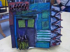 great project idea for middle school - cityscape with cardboard, paint black, the overlay with pastels. This however, is very flat. I suggest making it more 3D. Play with perspective! Use in 4th Q. elective class