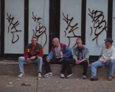 Each man is wearing the same articles of clothing (jeans, windbreakers, sneakers, shaved heads) associated with Gabbers, yet each one expresses their unique personality through those same clothes.