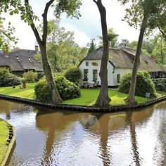 "Giethoorn is a village in the Netherlands, dubbed the ""Venice of the North"". The village has no motor-able roads, and all transport is done by water over one of the many intersecting canals."