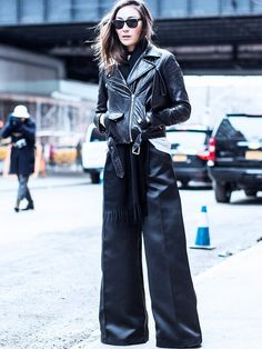 Style Notes: If you're going to wear a pair of pavement-scraping trousers, then get the length just so. Add a pair of chunky-heel ankle boots and a fitted biker jacket to get the balance spot on.