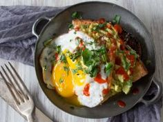 Spicy Egg-Topped Avocado Toast : <p><b>What You'll Need:</b>1 ripe avocado   1/2 lime   2 slices crusty toasted bread   2 eggs, fried   Sriracha   chopped cilantro</p>  <p></p>  <p><b>What to Do:</b>Cut avocado in half and remove the seed. Squeeze lime juice in each half of the avocado. Mash in its shell and spread over both slices of toast. Top each slice of toast with a fried egg, drizzle with Sriracha and sprinkle with fresh chopped cilantro.</p>