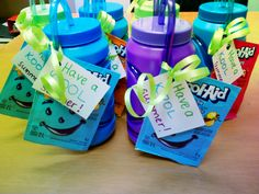 """Dollar store crazy-straw sippy cups, with packets of kool-aid attached saying """"Have a Kool Summer"""""""