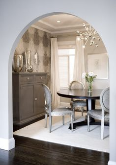Dining Room with Silver and Gray Accents + Mercury Glass + Mirror Finishes + Sputnik Chandelier