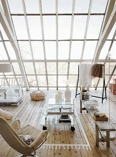 Apartment loft with sloped windows.