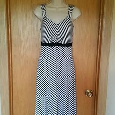 """Black and White Flowy Maxi Dress Brand tag has been cut out so is unknown. Purchased at T.J. Maxx. Would fit small to medium size. Length from shoulder to bottom is 58"""". Black band underneath  bust is 12.5"""" across. No flaws. Make me a reasonable offer! Dresses Maxi"""
