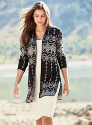 The versatile, double-face knit cardigan reverses from textural pinstripes to ornate graphics from a Thai ceremonial cloth. Cast in chambray, mango, dusty plum, raisin and navy pima, with drop shoulders, a buttonless placket and deep side slits.