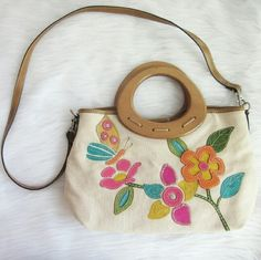Floral wooden handle Relic purse Excellent condition! Inside clean! Fun spring and summer bag. Long strap allows for shoulder carry. Canvas body. Wooden handle.  Bundle for best deals! Hundreds of items available for discounted bundles! You can get lots of items for a low price and one shipping fee!  Follow on IG: @the.junk.drawer Relic Bags