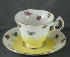 Paragon Bone China Tea Cup and Saucer Embossed Yellow with Mini Roses Violets