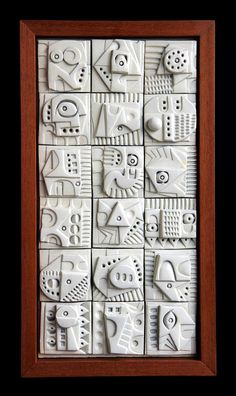Ron Hitchens, the British ceramist and artist, was best known in the 1960s for his elaborate reliefs made up of terracotta tiles distinctively carved with abstract imagery. This wall-plaque is made up of eighteen such tiles.