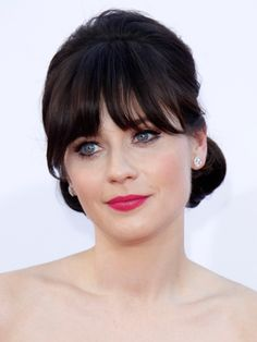 This season's take on pink lips makes it look like you've been eating raspberries all afternoon and the pinkish purple color of them has stained your lips. Case in point: Zooey Deschanel at the 2012 Emmy Awards—and at Rochas fall 2012 show. Couple this swipe of color with minimal face makeup and some mascara for a fresh–faced look. Try 29 Cosmetics Grape Seed Age Protecting Lipstick in Wine Critic, $25, 29cosmetics.com.