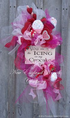 """Cupcake Valentine Swag. An adorable painted plaque boasts """"You are the Icing on my Cupcake"""", surrounded by three cupcakes, an abundance of sweet treats and swirls and bows of tulle and sheer ribbon in"""