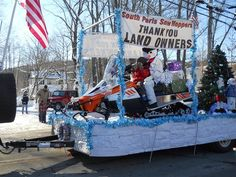 Four wheeling Santa in the Christmas Parade. | Snowmobiles ...