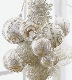 White Winter Wonderland Theme Ornaments make a pretty grouping even without a tree                                                                                                                                                                                 More