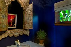 Blue bloods. The ancient Egyptians used the lapis lazuli stone to dye the cloaks of royals and priests, indicating their status as gods. We still see these rich celestial hues as somehow exotic and regal, so they work beautifully on feature walls or in small spaces, such as this powder room.