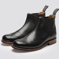 Grenson Jessie Black Chelsea Boot: Jessie Black Chelsea Boot by Grenson. The Chelsea boot is a staple that combines with nearly any look; from skirts to classic jeans, it makes a stunning choice. These beautiful Grenson Jessie boots are made to last, with a beautiful cutout design.