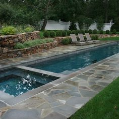 pool with stone wall - Google Search