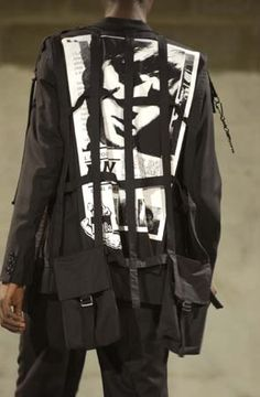 i like the grunge old almost punk feeling this jacket gives off. the lines and graphic on the back give it a very edgy look which is much like my aesthetic.