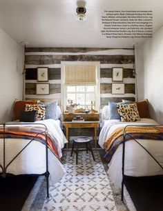 Bedroom with two beds.  Idea for a shared bedroom.  Desk between the beds.
