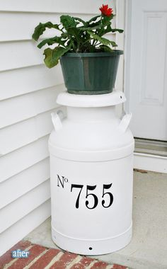 Repurpose a vintage old metal milk can into a front porch house number sign. Choose a more attractive pot and plant though