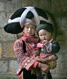 mother and child in folk costumes.