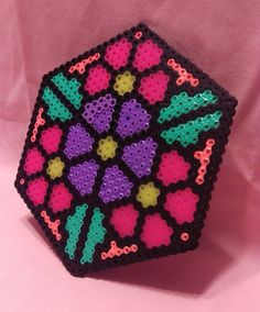 6 by 6 perler charm -perfect for hanging in a window -can easily be made into a necklace for raves -unique design Perler Bead Designs, Easy Perler Bead Patterns, Melty Bead Patterns, 3d Perler Bead, Perler Bead Templates, Hama Beads Design, Beading Patterns, Melty Beads Ideas, Melted Bead Crafts